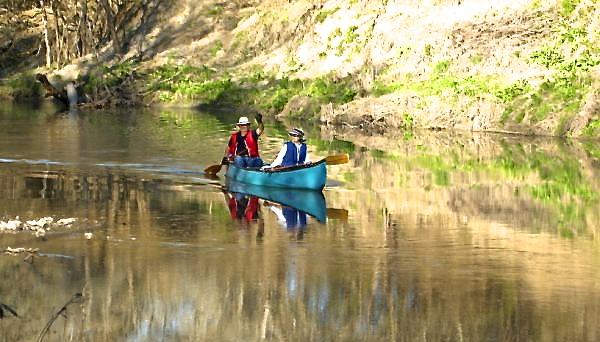 couple on canoe down the river