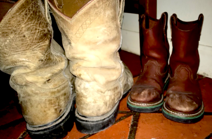 Large and small well worn cowboy boots