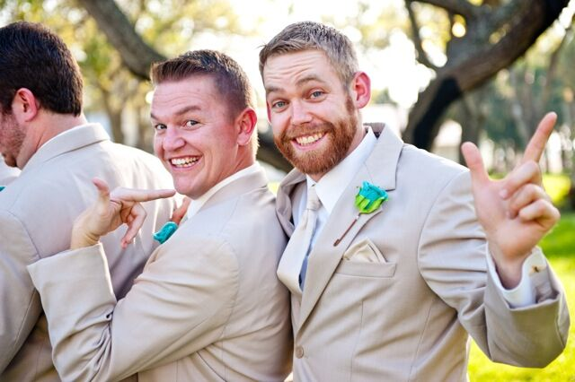 groomsmen smiling at the camera