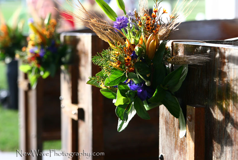 flower arrangements on church pews