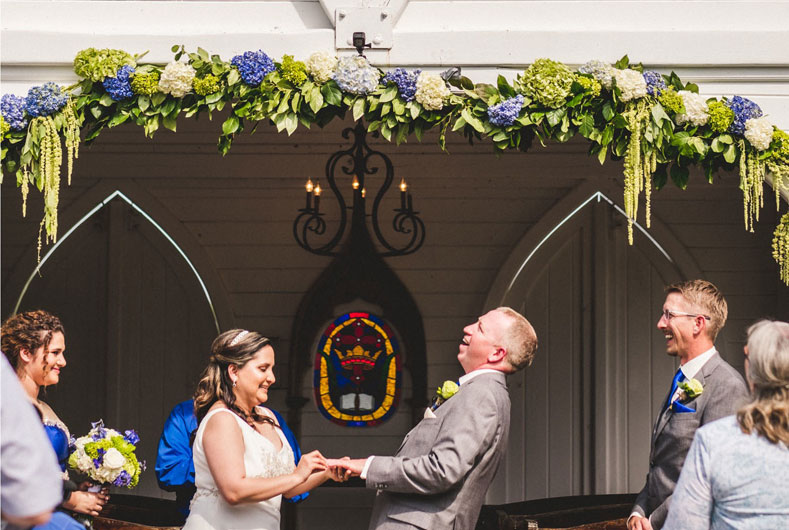 outdoor wedding in the chapel with beautiful flower arch