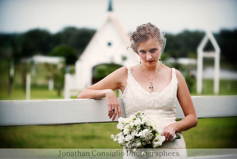 young bride holding bouquet with chapel in the background