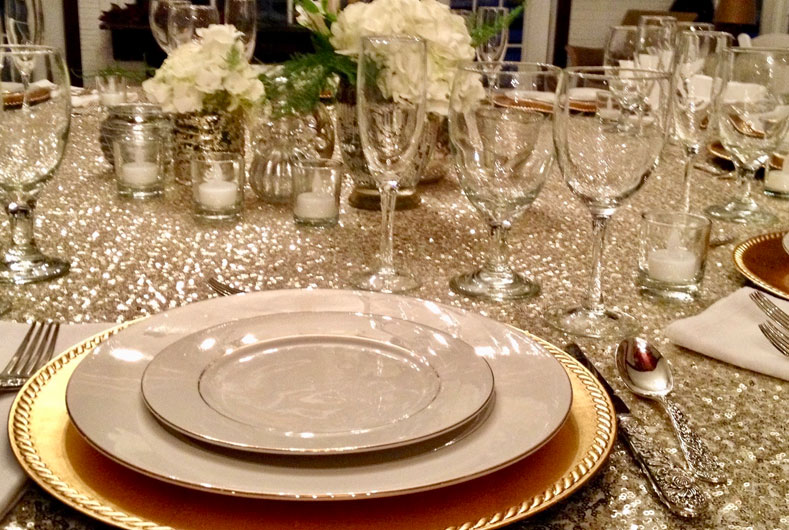 beautifully set table with china and crystal