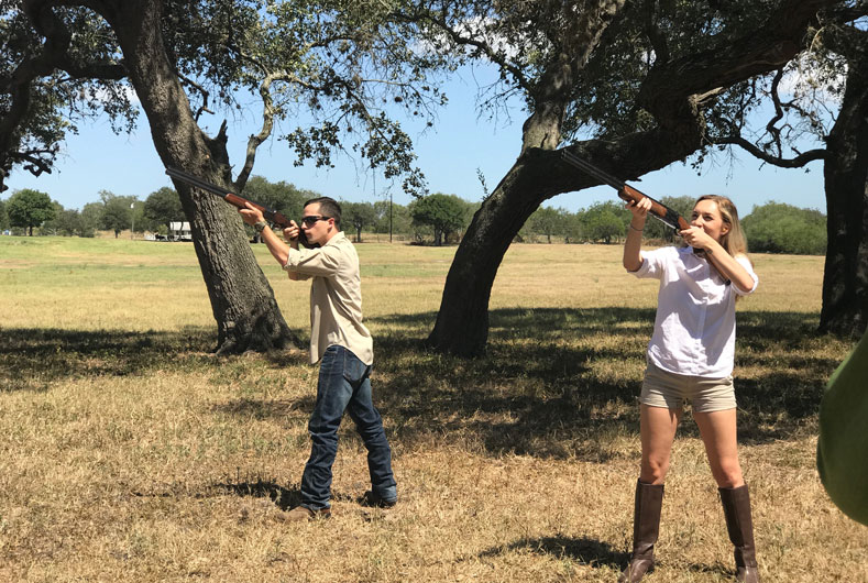 Young couple skeet shooting