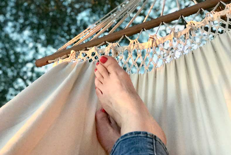 someone relaxing on a hammock